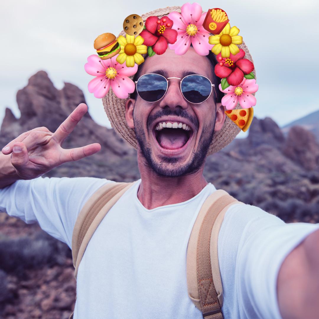 Guy wearing fast food emoji crown
