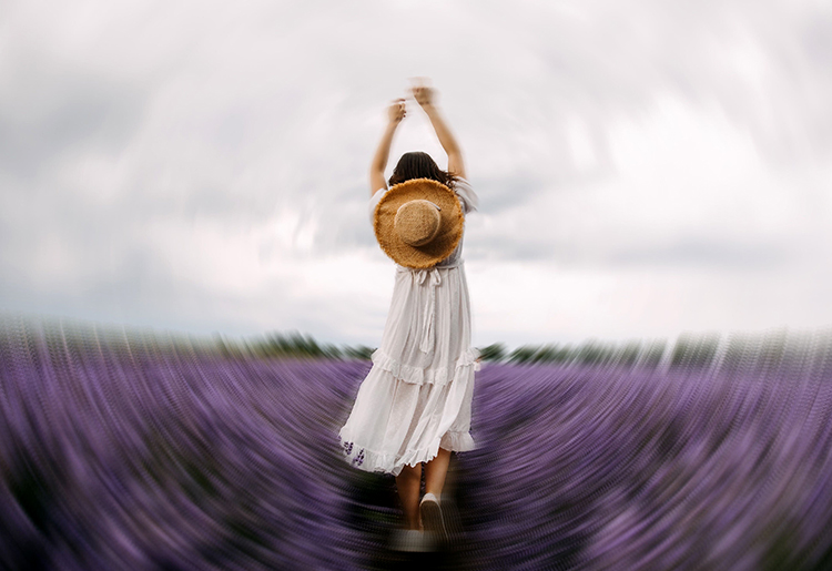 Blur background effect with girl in a white dress and a hat made with photo editor
