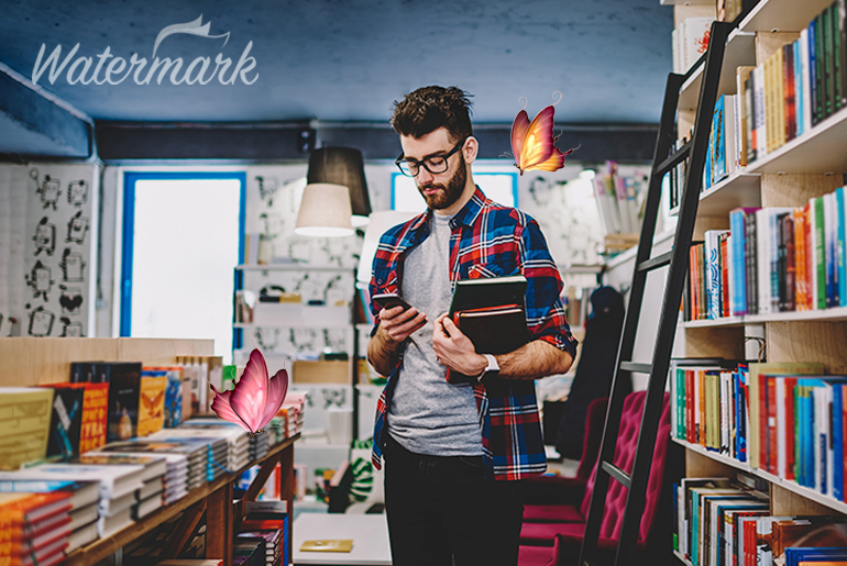 Watermark photo of a guy in a bookstore