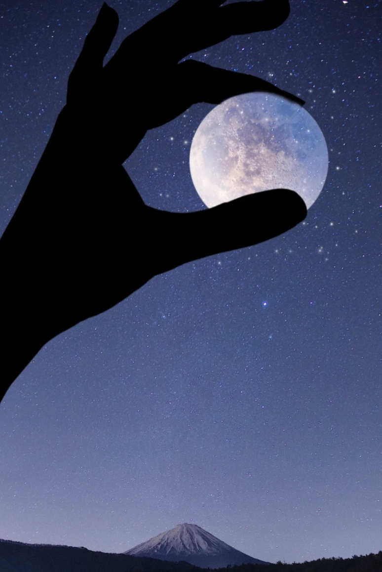 Hand holding the moon