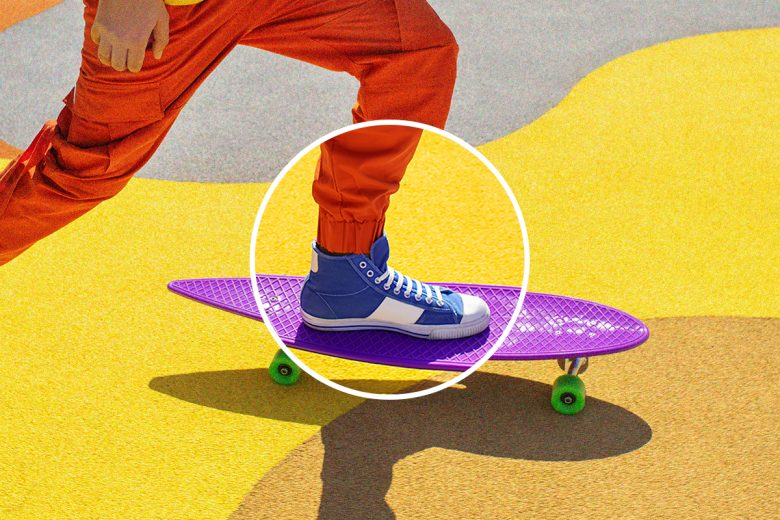 Colorful skateboard and sneakers