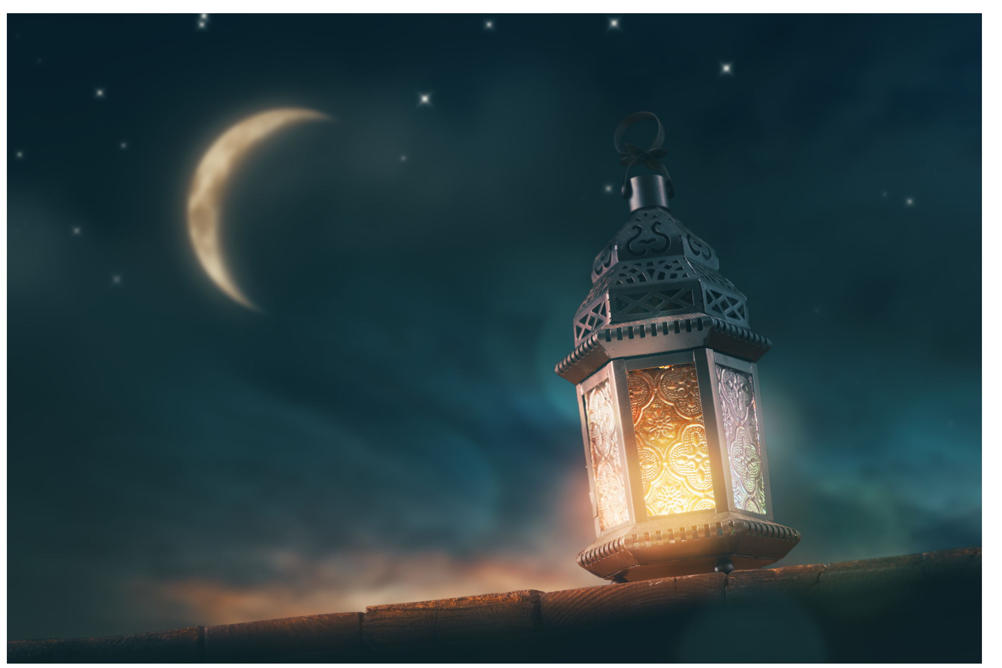 surreal stock photo of a lantern and moon